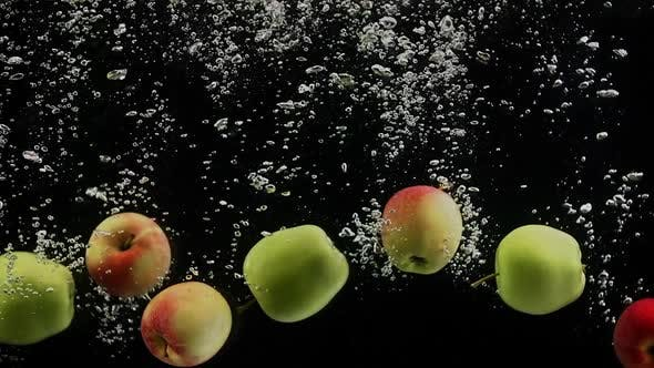 Cover Image for Ripe Fruits Green and Red Apples Falling Into Water Black Background