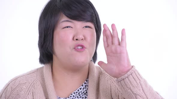 Thumbnail for Face of Stressed Overweight Asian Woman Getting Bad News for Winter