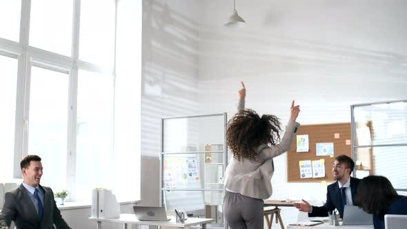 Thumbnail for Excited Business Team Celebrating Achievement in Office