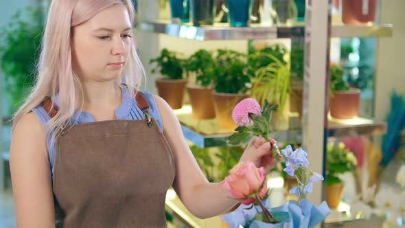 Thumbnail for Calm Woman with Loose Hair Enjoys Making Decorative Bouquet