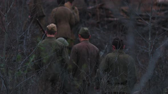 Soldiers Walking on the Scorched Ground of the Forest