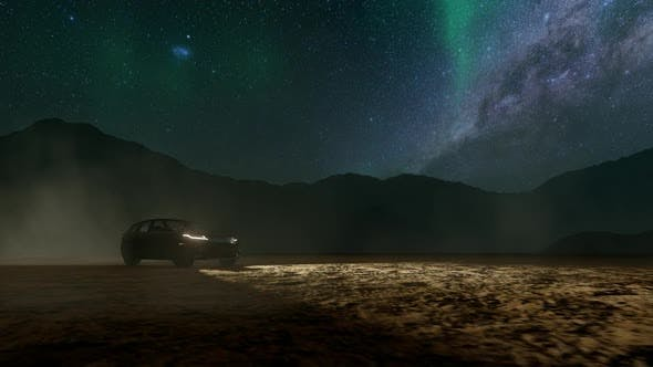 SUV Drives Through Mountain Terrain with Milky Way View