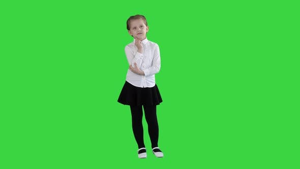 Thumbnail for A Curious Little Girl Stands and Thinks on a Green Screen, Chroma Key