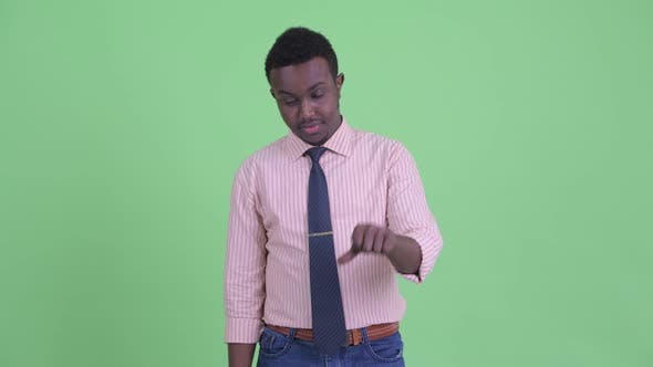 Cover Image for Sad Young African Businessman Giving Thumbs Down