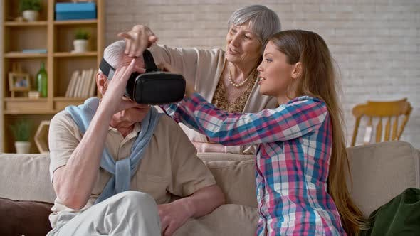 Thumbnail for Young Woman Explaining Virtual Reality to Grandfather