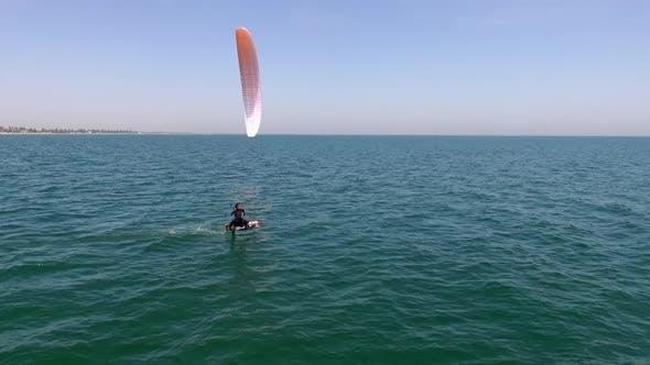 Slowmotion Drone Side Footage Male Sportsman Kiteboarding Catching Wind Like Extreme Water Sports