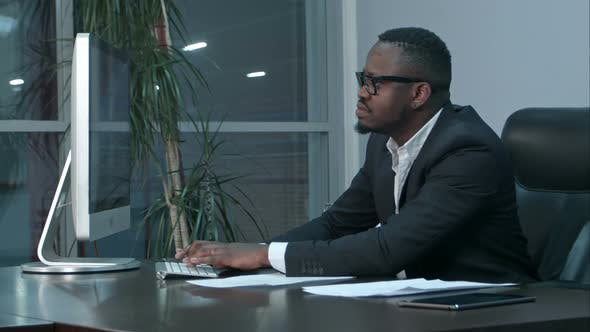 Thumbnail for Handsome Afro-american Businessman Working and Typing on Laptop in the Office