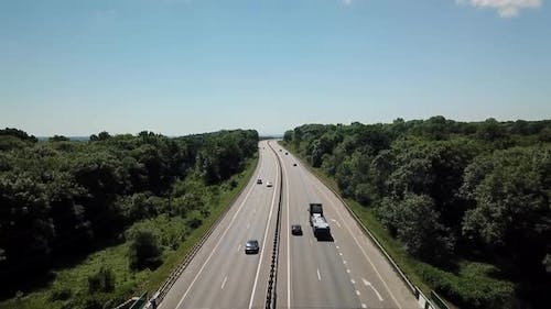 Aerial Shot Of A Highway Passing Through The Rural Countryside