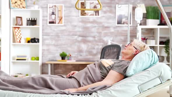 Thumbnail for Old Lady Lying on Hospital Bed in Nursing Home