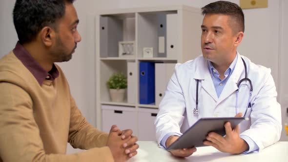 Thumbnail for Male Doctor with Tablet Pc and Patient at Hospital 23