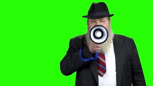 Confident Businessman Making an Announcement Into Megaphone