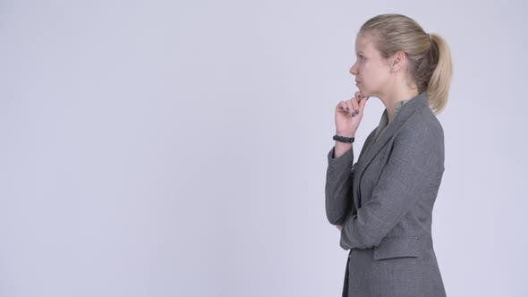 Thumbnail for Profile View of Young Happy Blonde Businesswoman Thinking