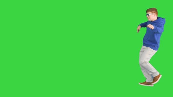 Thumbnail for Teenager Boy Walking By and Dancing on a Green Screen Chroma Key