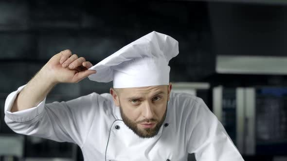 Thumbnail for Chef Man Posing at Professional Kitchen. Male Chef Preparing To Cook at Kitchen