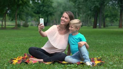 Mother and Child Taking Selfie With Smartphone, Enjoying Family Weekend Together