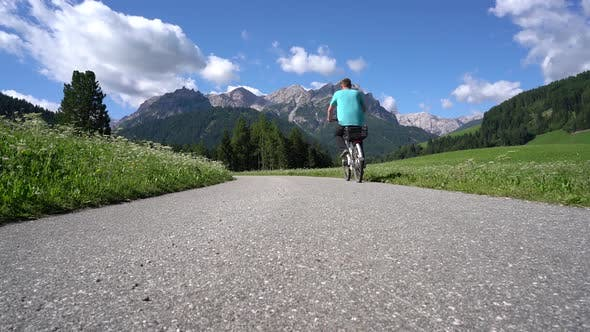 Thumbnail for Man on Electric Eco Bike Cycling Italy Dolomites Alps