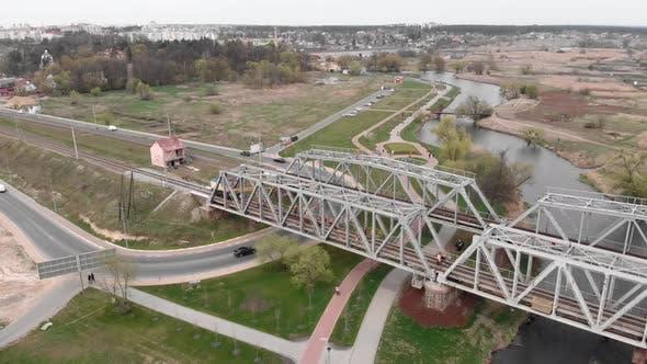 Repair of railway bridge over river, aerial drone view. Bridge reconstruction.