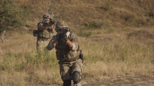 Anonymous Military Man Aiming Rifle