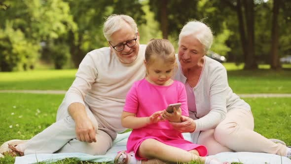 Thumbnail for Grandparents and Granddaughter with Smartphone