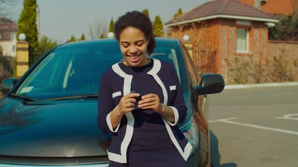 Thumbnail for Excited New Car Owner Woman Holding Car Keys