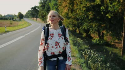 Wanderlust: Young Travelling Woman Leaves House with Backpack.