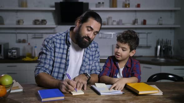 Thumbnail for Positive Father Giving Housework Tasks To His Son