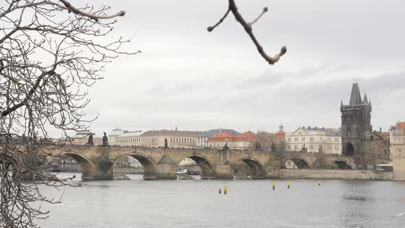Thumbnail for Czechia capital  Vltava river and famous Charles bridge slow tilt 4K 2160p 30fps UltraHD footage - C