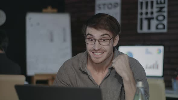 Thumbnail for Joyful Businessman Looking at Laptop Screen and Doing Yes Gesture in Dark Office
