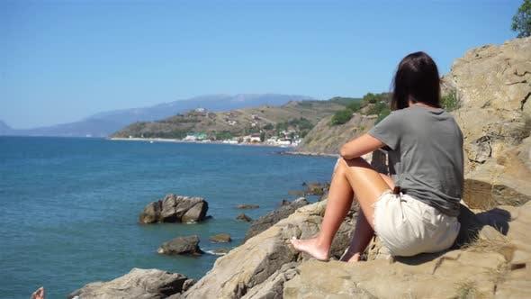 Thumbnail for Tourist Woman Outdoor on Edge of Cliff Seashore
