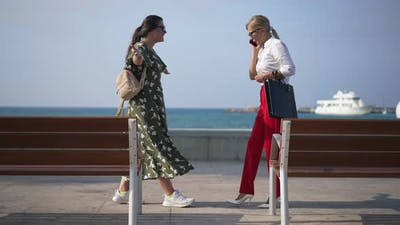 Busy Businesswoman Meeting Friend on City Embankment