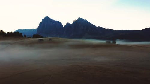 Autumn Morning and Bright Misty Sunrise in the Valley of Compaccio