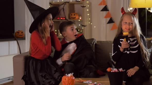 Thumbnail for Kids in Halloween Costumes Playing at Home