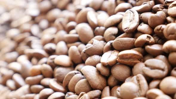 Thumbnail for Shallow DOF coffee beans  background  arabica type slow panning 4K 3840X2160 UHD video - Fresh roast