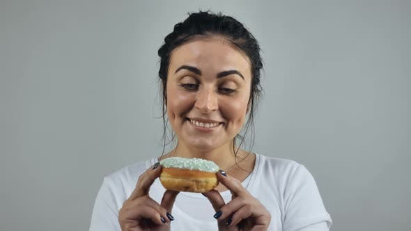 Thumbnail for Female Looking on Donut  Video Prores