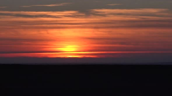 Thumbnail for Sunset Over Horizontal Thin Cloud Layers