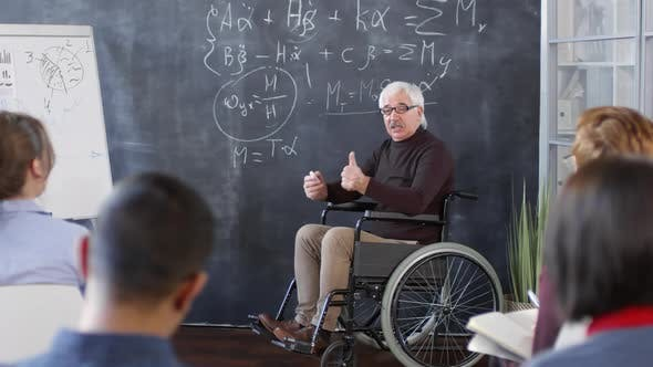 Thumbnail for Mature Professor in Wheelchair Talking to Students
