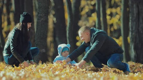 Baby Child Mother Father Have Fun in Autumn Leaves