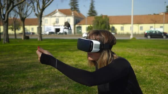 Thumbnail for Girl Using Virtual Reality Headset in Park
