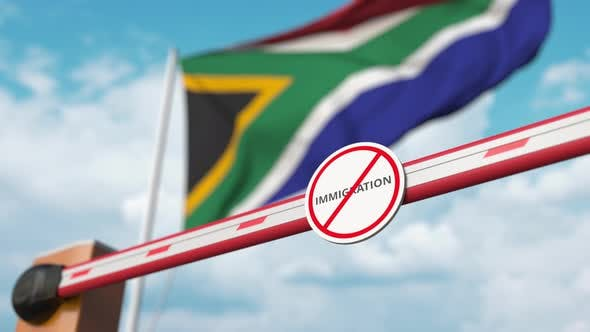 Barrier with No Immigration Sign Opened at Flag of South Africa