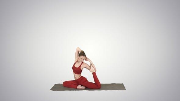 Thumbnail for Beautiful young woman wearing red sportswear doing yoga
