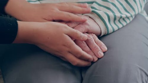 Children's Hands Take the Hands of the Grandmother
