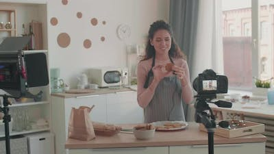 Young Woman Trying Cookies for Tutorial