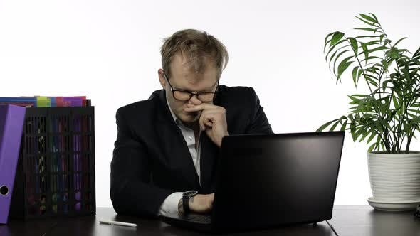 Thumbnail for Tired Sleepy Businessman Working Hard in Office on Laptop Falling Asleep