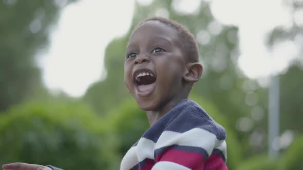Cover Image for Portrait of an African American Child Smiling and Looking Into the Camera