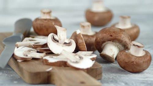 Sliced Mushrooms on a Cutting Board Slowly Rotate.