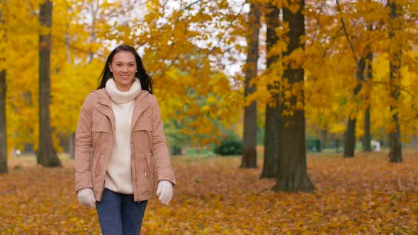 Thumbnail for Happy Young Woman Walking in Autumn Park 2
