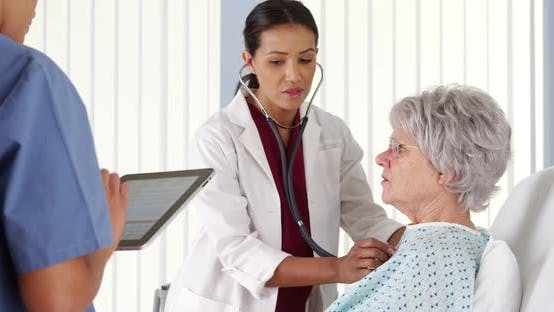 Thumbnail for African American doctor listening to mature patient's breathing with stethoscope