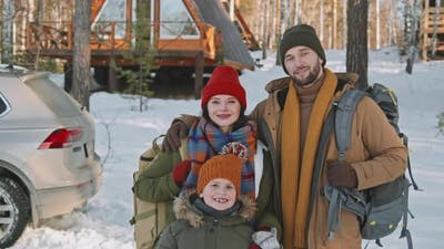 Happy Family Posing on Winter Getaway