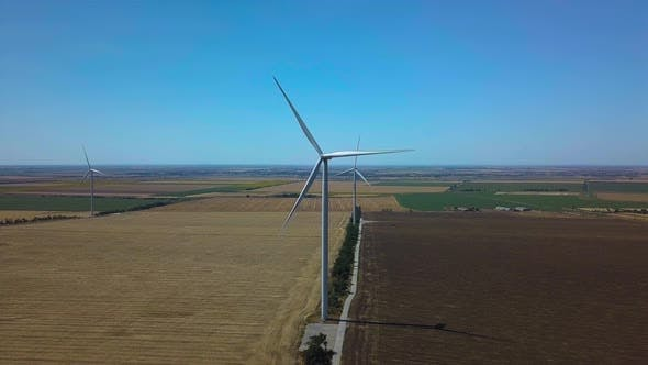 Thumbnail for Aerial View of Windmills Rotating By the Force of the Wind and Generating Renewable Energy