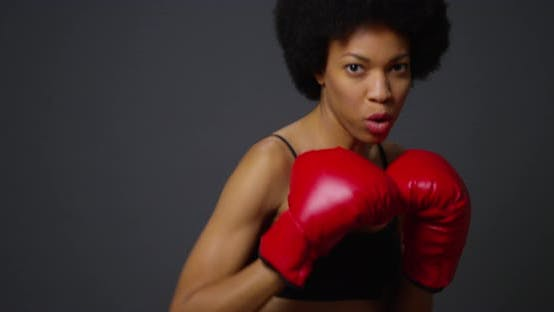 Thumbnail for Black woman boxer punching towards camera